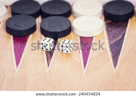 Old wooden backgammon game and dices - stock photo