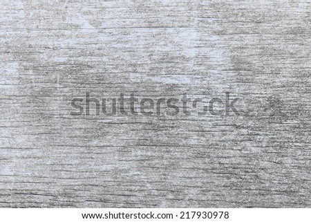 Old wooden background of weathered distressed rustic wood with faded light blue paint showing woodgrain texture - stock photo