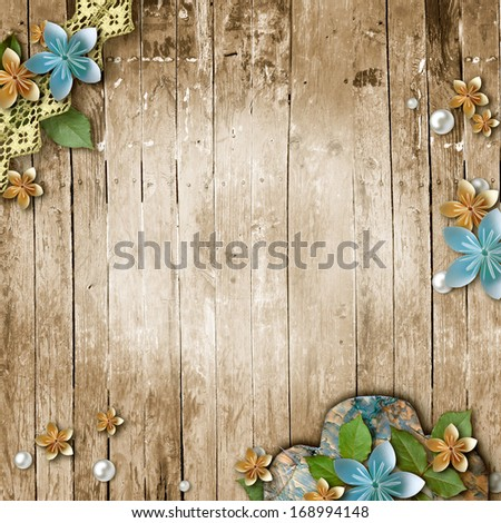 Old wooden background with a flowers, pearls  - stock photo