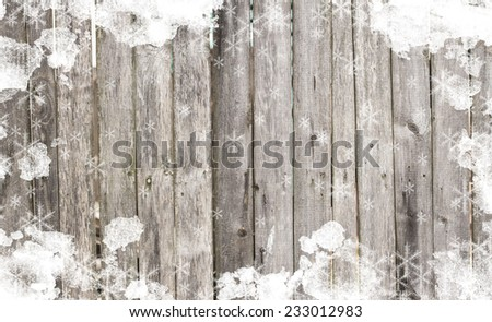 Old wooden background with snow for design. Christmas background