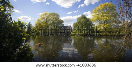 Old wooden bandstand on lake, wide angle shot - stock photo
