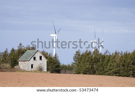 Old wooden barn and windmills - stock photo