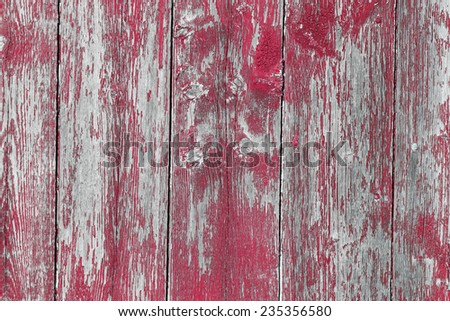 Old wooden barn board with distressed blue paint. - stock photo