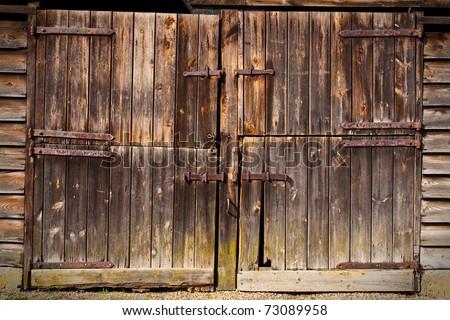 Old wooden barn door - stock photo