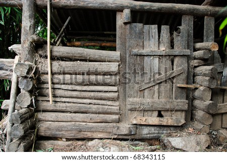 old wooden barn door in the forest in china