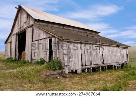 Old Wooden Barn, Hay, Sky - stock photo