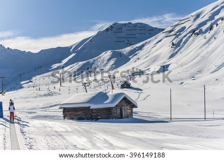 Old wooden barns surrounded by deep snow with skiing tracks in the Dolomites, South Tyrol, Italy, Europe
