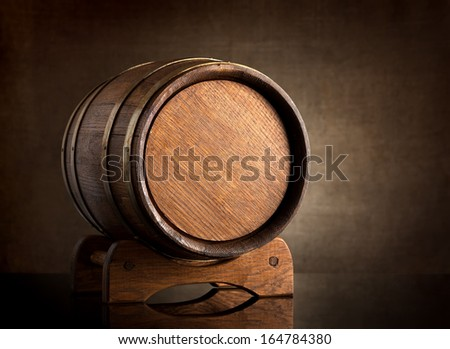 Old wooden barrel on a background of canvas - stock photo