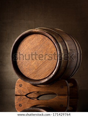 Old wooden barrel on a brown background - stock photo