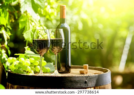 Old wooden barrel with glass of red wine.  - stock photo