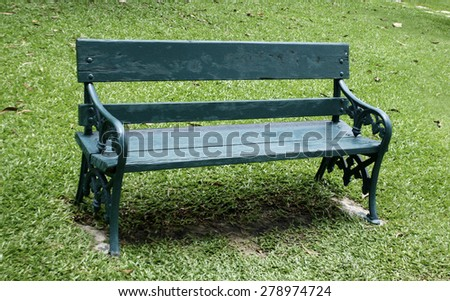 Old wooden bench in park - stock photo