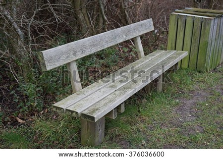 old wooden bench outside - stock photo