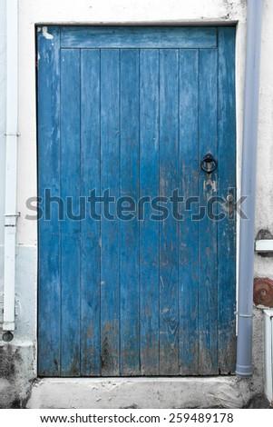 Old wooden blue door - stock photo