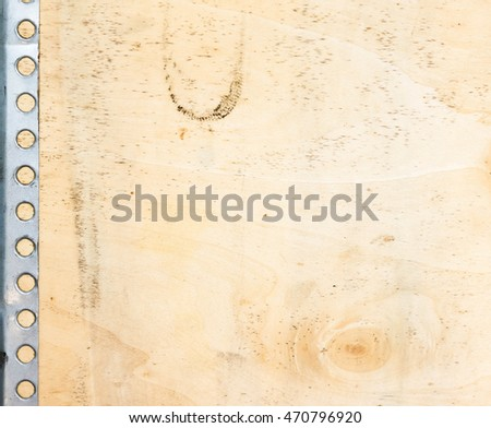 Old wooden board and metal frame as background and frame