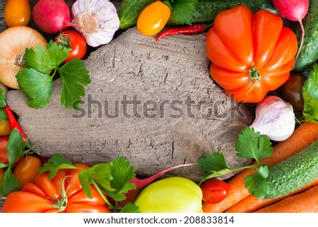 old wooden board for text, spices and fresh vegetables, top view, close-up - stock photo
