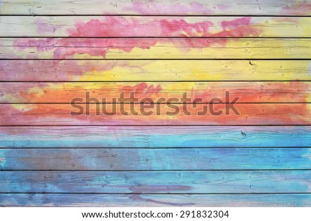 Old wooden board in rainbow colors, good structure and detail - stock photo