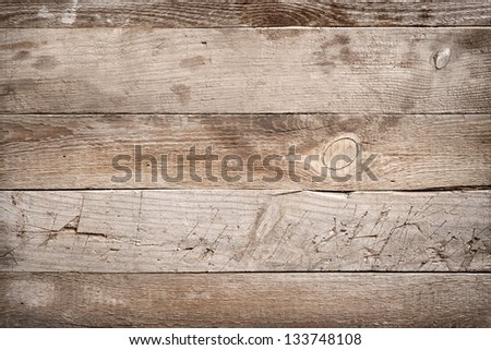 Old wooden board painted dark color - stock photo