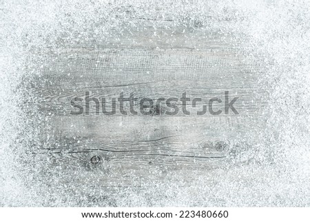 Old wooden board with snow flakes . Christmas background - stock photo