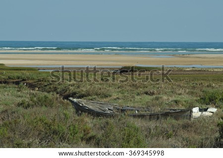 Old wooden boat abandoned on the coast. Beaches and seascapes - stock photo