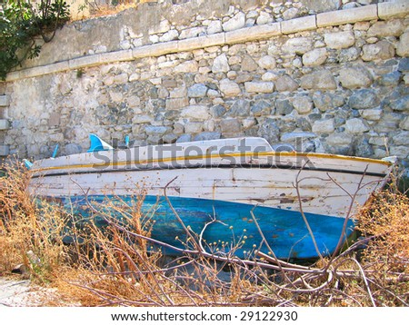 old wooden boat, behind a wall - stock photo