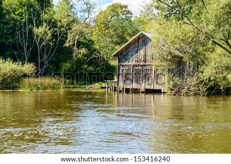 Old wooden boat house by the creek.