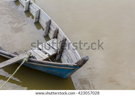 old wooden boat is sinking - stock photo