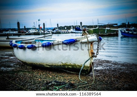 Old wooden boat moored in harbour at Inchedon, West Sussex. United Kingdom - stock photo
