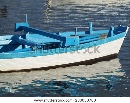 old wooden boat on the sea        - stock photo