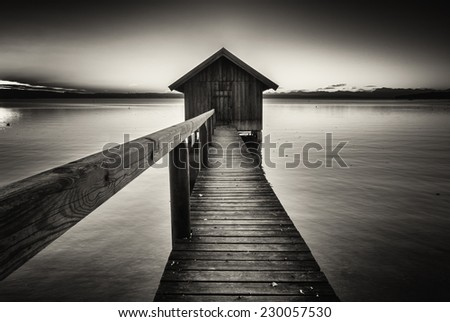 old wooden boathouse at a lake - stock photo