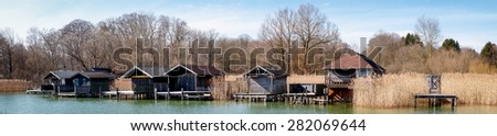 old wooden boathouses at a lake - stock photo