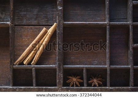 Old wooden bowl with cinnamon and anise - stock photo