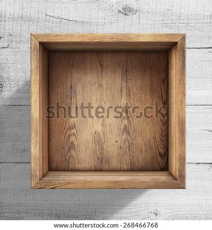 Old wooden box on white wood floor - stock photo