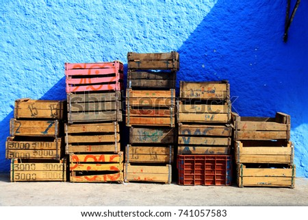 Old Wooden Boxes For Fruits And Vegetables Stacked In A Street In  Chefchaouen, Morocco