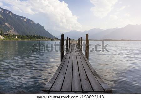 Old wooden bridge. - stock photo
