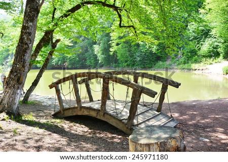 Old wooden bridge in Dilijan national park, Armenia - stock photo