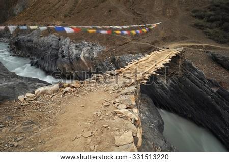 Old wooden bridge, Ladakh, India,  - stock photo