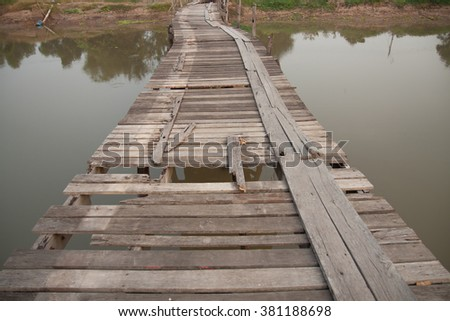 Old wooden bridge over canal