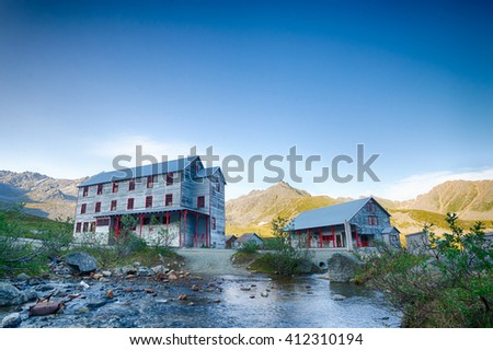 Old wooden buildings are all that remain of Independence Gold Mine. - stock photo