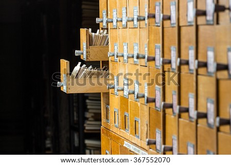 Old wooden card catalog in the archive library - stock photo
