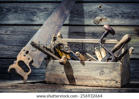 Old wooden carpenters box with tools - stock photo
