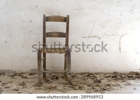 old wooden chair on white background, dust and cobwebs on the chair, natural light, front view