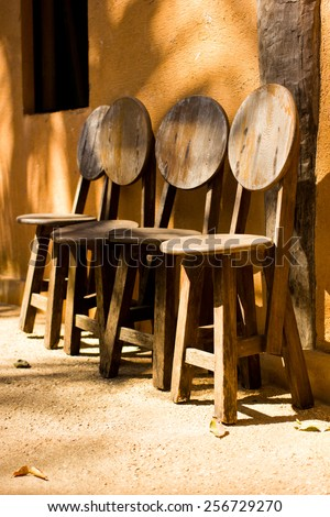 old wooden chairs at the old market of artist in thailand - stock photo