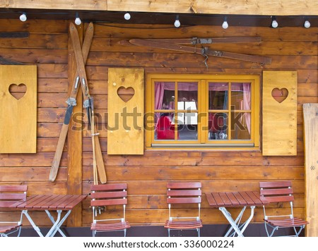 Old wooden chalet with decoration background - stock photo