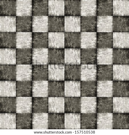 Old wooden chess board in black and white, top view
