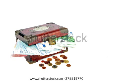 Old wooden chest with euro banknotes and coins - stock photo