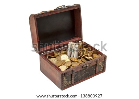 Old wooden chest with golden coins isolated on white background