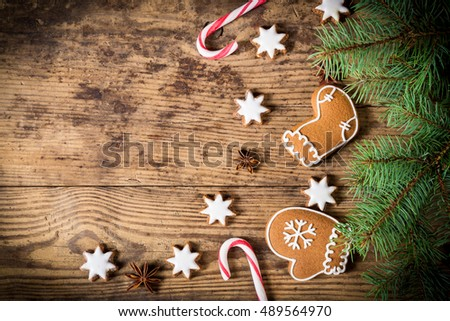 Old wooden christmas background with gingerbread cookies,lantern and fir branch, empty space for text