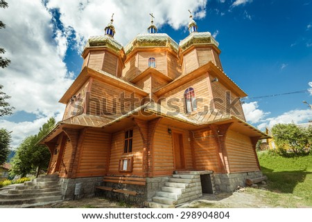 old wooden church against the blue sky wooden - stock photo