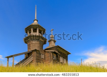 Old wooden Church in the village in the summer