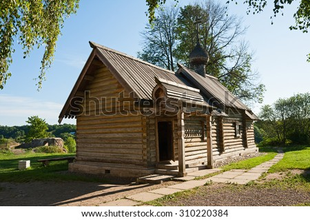 Old wooden Church of St. Demetrius of Thessaloniki in the fortress of Staraya Ladoga - stock photo